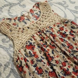 Vibrant floral top with crochet embellishment
